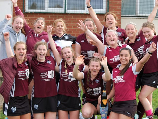Bedford Hockey Club Ladies' 2s celebrate their victory and promotion to the Premier Division