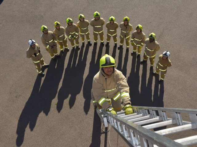 Beds firefighters ladder group shot