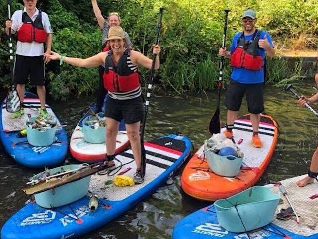 Plastic Patrol paddle boarding