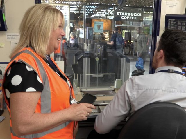 Station manager, Bernadette Lee, chats to ticket office staff