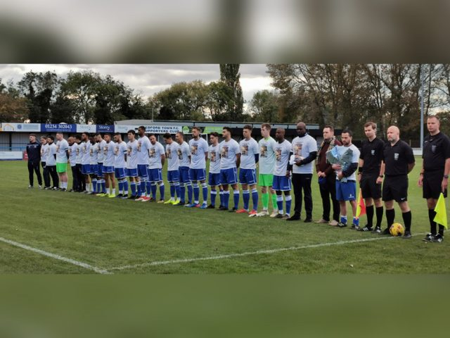 Bedford Town Players and officials line up for pre match tribute.