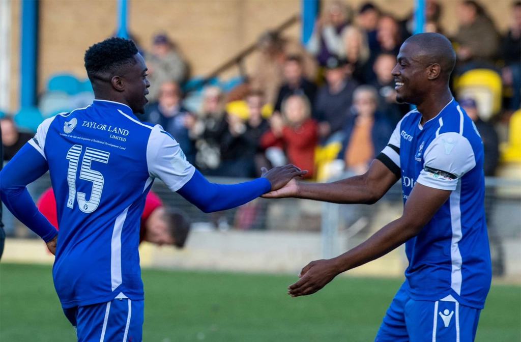 Nathan Olukamni celebrates his goal with Ebby Nelson-Addy
