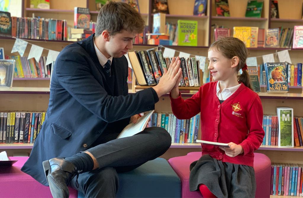 Bedford School boy reading at Scott Primary