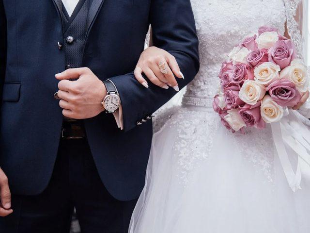 Wedding bride groom arm in arm