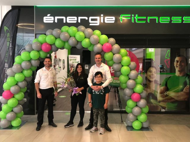 Jake and Francine Amos and their son open energie Fitness with manager Lee (L)