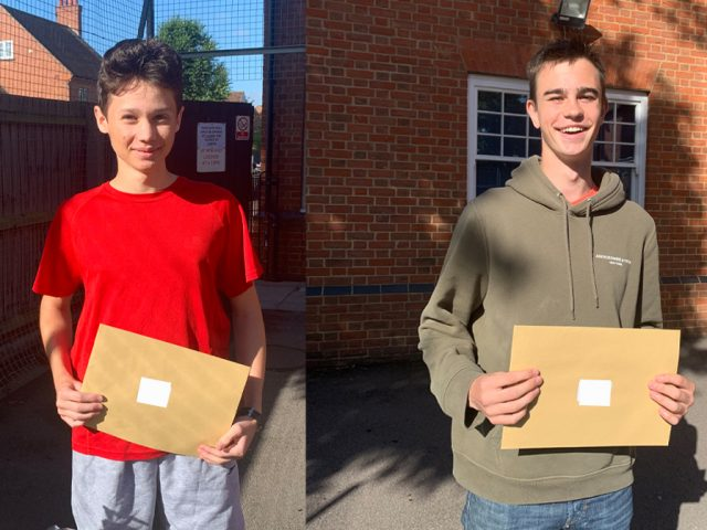 (l-r) Olivier Gaillard and Oscar Smith from Rushmoor school collecting their results.
