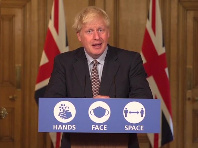PM Boris Johnson hands face space