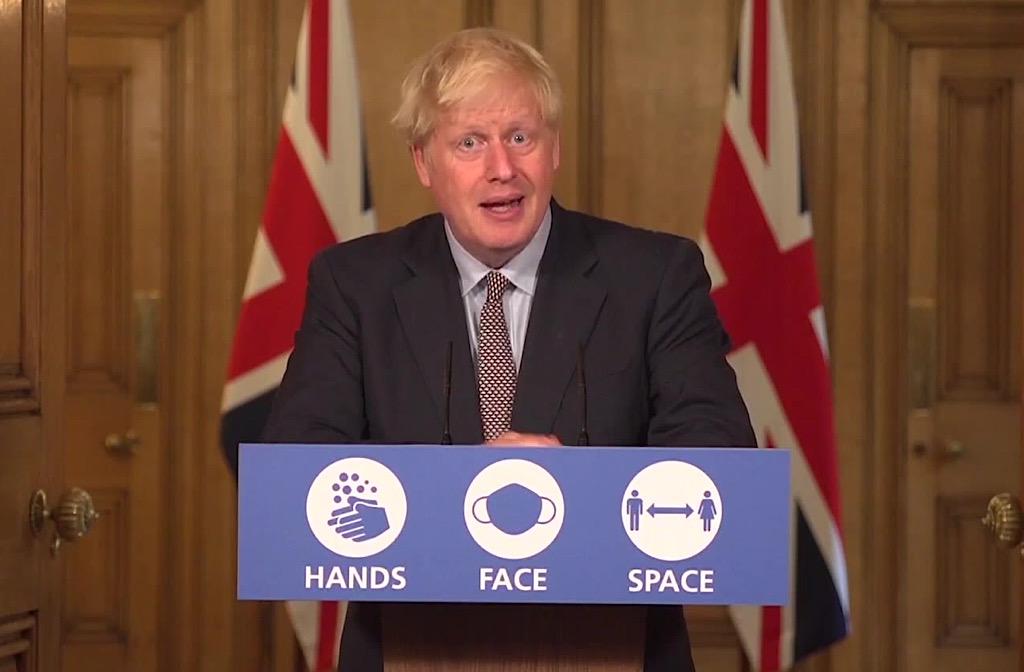 PM Boris Johnson hands face space