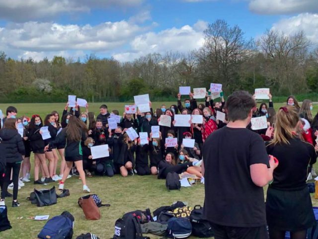 Female pupils protested on the field at Sharnbrook Academy at what they called