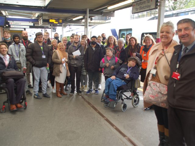 Pathways Tutor Nicky Noble and Luton Airport Parkway station manager Joe Healy (right) with students and companions at Bedford station and Carl Martin, Accessibility Lead (left)