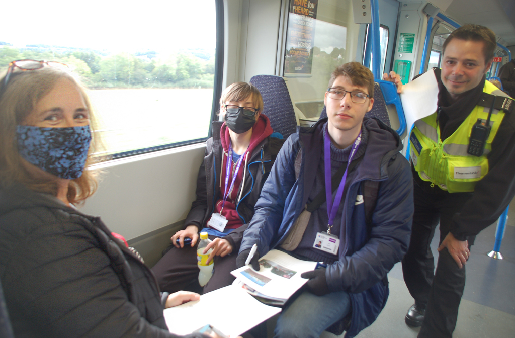 Pathways teaching assistant Margaret Cootes sits opposite students Jake Murray (left) and Charlie Cook (right), assisted by a member of Thameslink on board staff.